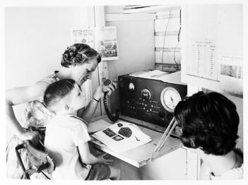 Queensland_State_Archives_2986_A_School_of_the_Air_primary_student_in_regional_Queensland_takes_class_via_two_way_radio_c_1960
